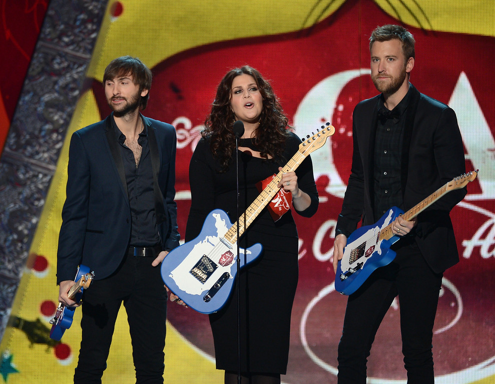 Description of . LAS VEGAS, NV - DECEMBER 10:  (L-R) Musicians Dave Haywood, Hillary Scott, and Charles Kelley of Lady Antebellum accept the Duo/Group Artist of the Year award onstage during the 2012 American Country Awards at the Mandalay Bay Events Center on December 10, 2012 in Las Vegas, Nevada.  (Photo by Mark Davis/Getty Images)