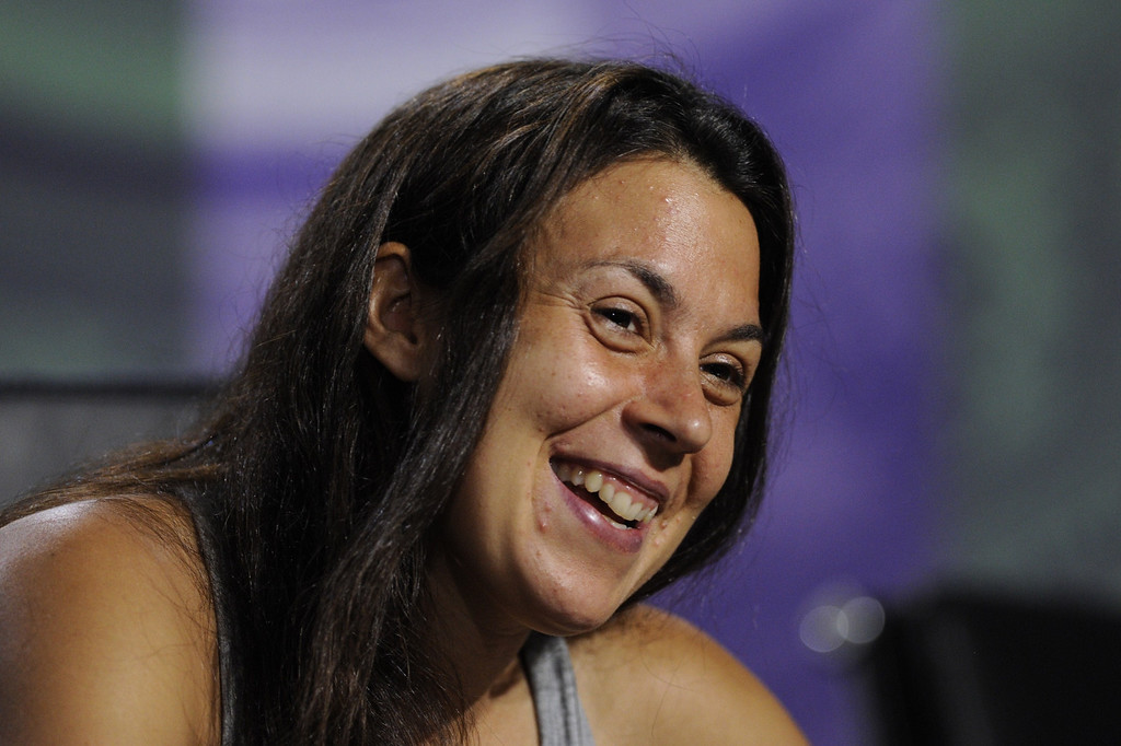 Description of . France's Marion Bartoli speaks during a press conference after defeating Germany's Sabine Lisicki to win the women's singles final on day twelve of the 2013 Wimbledon Championships tennis tournament at the All England Club in Wimbledon, southwest London, on July 6, 2013. Bartoli won 6-1, 6-4.  AFP/Getty Images