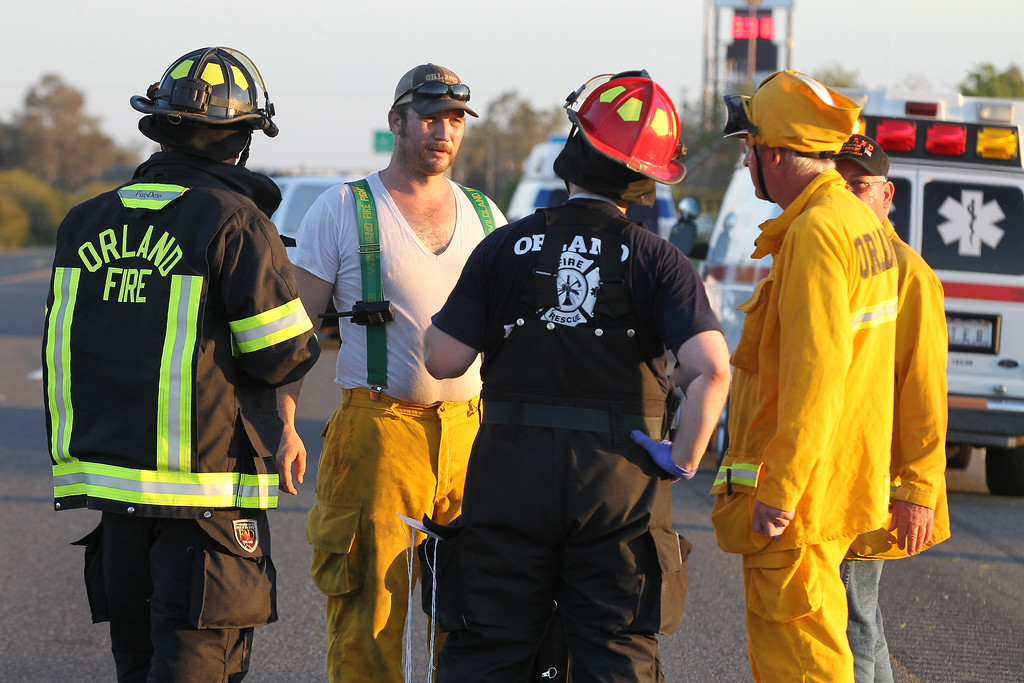 Description of . Rescue workers, police and firefighters work the scene where nine people were killed in a three-vehicle crash involving a bus carrying high school students on a visit to a college, Thursday, April 10, 2014, near Orland, Calif. Authorities said it is not yet clear what caused the crash but that it involved a tour bus, a FedEx truck and a Nissan Altima. (AP Photo/The Record Searchlight, Greg Barnette)