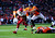 Kansas City Chiefs cornerback Brandon Flowers (24) returns a fumble in the second quarter and is brought down by Denver Broncos tight end Joel Dreessen (81) as the Denver Broncos took on the Kansas City Chiefs at Sports Authority Field at Mile High in Denver, Colorado on December 30, 2012. AAron Ontiveroz, The Denver Post