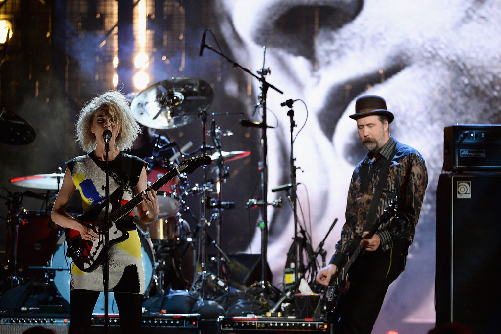 Description of . Musican St. Vincent (L) and Krist Novoselic perform onstage at the 29th Annual Rock And Roll Hall Of Fame Induction Ceremony at Barclays Center of Brooklyn on April 10, 2014 in New York City.  (Photo by Larry Busacca/Getty Images)
