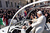 Pope Benedict XVI travels through the crowd in the popemobile in St Peter's Square on February 27, 2013 in Vatican City, Vatican. The Pontiff will hold his last weekly public audience later before he abdicates tomorrow. Pope Benedict XVI has been the leader of the Catholic Church for eight years and is the first Pope to retire since 1415. He cites ailing health as his reason for retirement and will spend the rest of his life in solitude away from public engagements.  (Photo by Carsten Koall/Getty Images)