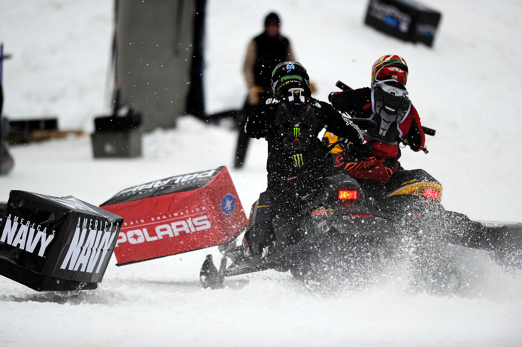 Description of . ASPEN, CO - January 26: Joe Parsons, left, and Willie Elam, right, tangle for the second time during the start of the Snowmobile Speed & Style bronze medal match at Winter X Games Aspen 2013 at Buttermilk Mountain on Jan. 26, 2013, in Aspen, Colorado. Parsons eventually took bronze after the next start was clean. (Photo by Daniel Petty/The Denver Post)