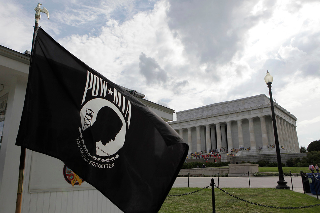 Description of . The POW/MIA flag waves near the Lincoln Memorial before Memorial Day in Washington May 23, 2013. The flag was designed during the Vietnam War as a symbol of national concern about U.S. military personnel taken as prisoners of war (POWs) or listed as missing in action (MIA). REUTERS/Yuri Gripas