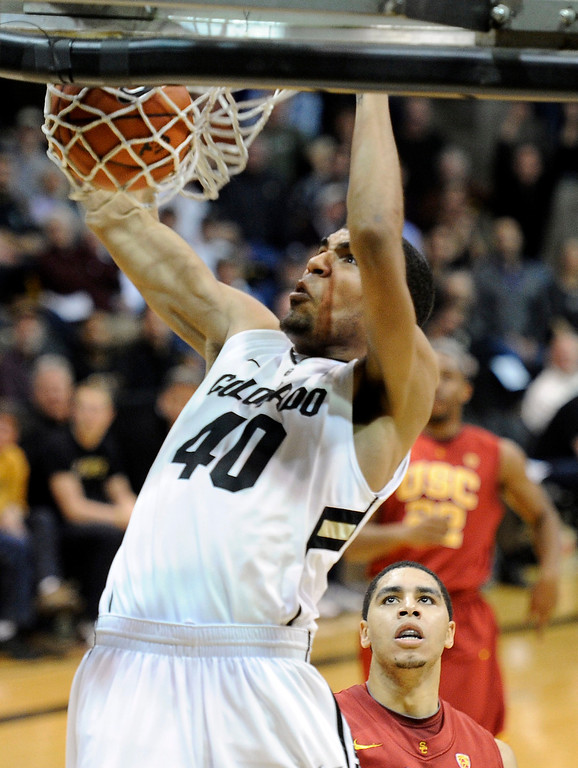 Description of . University of Colorado's Josh Scott dunks the ball after a fast break during a game against the University of Southern California on Thursday, Jan. 10, at the Coors Event Center on the CU campus in Boulder. Jeremy Papasso/Daily Camera
