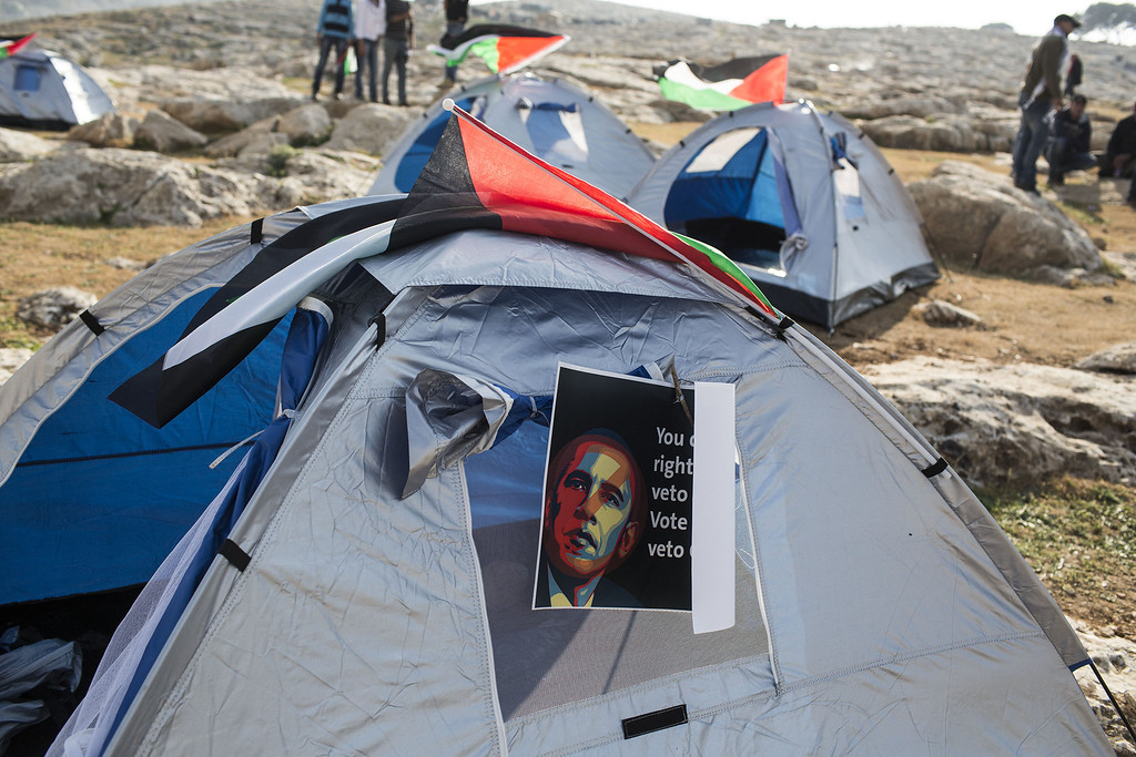 Description of . A poster bearing an image of U.S. President Barack Obama  is posted on a tent as Palestinians erect protest tents in a camp on March 20, 2013 in the E1 area next to Ma'ale Adumim. The action took place at the same time as U.S. President Barack Obama arrived to Ben Gurion airport near Tel Aviv. (Photo by Ilia Yefimovich/Getty images)