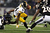 Wide receiver Antonio Brown #84 of the Pittsburgh Steelers is pulled down by cornerback Chykie Brown #23 of the Baltimore Ravens in the first quarter at M&T Bank Stadium on December 2, 2012 in Baltimore, Maryland. (Photo by Patrick Smith/Getty Images)