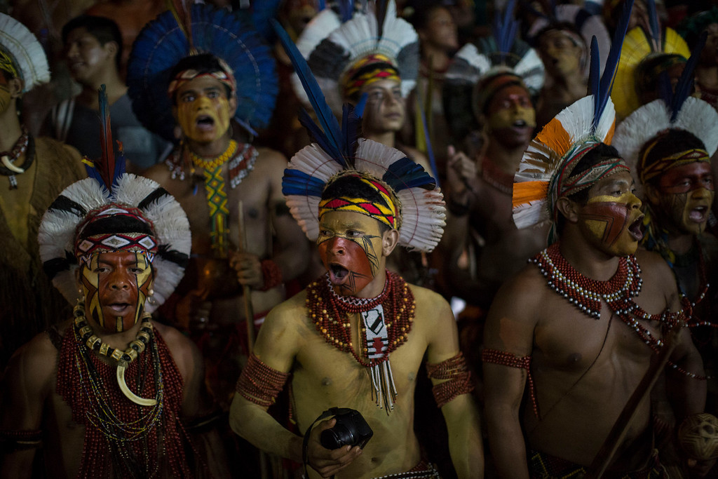 Description of . Pataxo Indians sing during the indigenous games in Cuiaba, Brazil, Tuesday, Nov. 12, 2013.  (AP Photo/Felipe Dana)