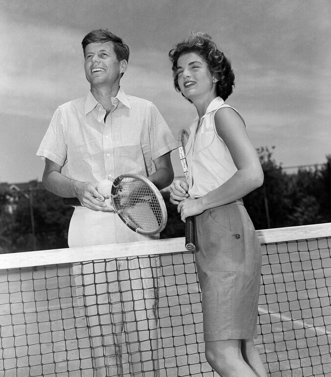 Description of . Sen. Kennedy and his fiancee, Jacqueline Bouvier, 23, meet at the net as they prepare for a game of tennis at the Kennedy residence at Hyannis, Mass., on June 27, 1953, where they were spending the weekend. Associated Press file