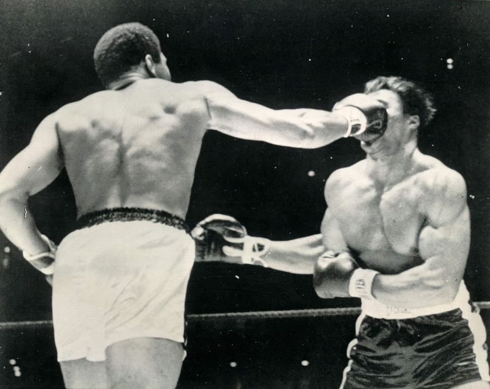 Description of . Right On The Button -- Heavyweight Champion Cassius Clay connects with a right to the face of Challenger Cleveland Williams in the second round of their championship fight in Houston tonight.  This blow sent Williams to the canvas for the third time in the round.  Williams was saved by the bell but Referee Harry Kessler halted the fight in the third round. 1966. Credit: AP