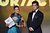 Presenters Nina Dobrev (L) and Henry Cavill speak onstage at the 18th Annual Critics' Choice Movie Awards held at Barker Hangar on January 10, 2013 in Santa Monica, California.  (Photo by Kevin Winter/Getty Images)