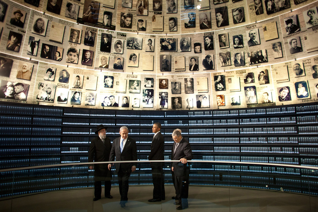 Description of . U.S. President Barack Obama visits the Hall of Names at the Yad Vashem Holocaust Memorial museum with (L-R) Rabbi Yisrael Meir Lau, Israel's Prime Minster Benjamin Netanyahu, Chairman of the Yad Vashem Directorate Avner Shalev and Israel's President Shimon Peres on March 22, 2013 in Jerusalem, Israel.  (Photo by Uriel Sinai/Getty Images)