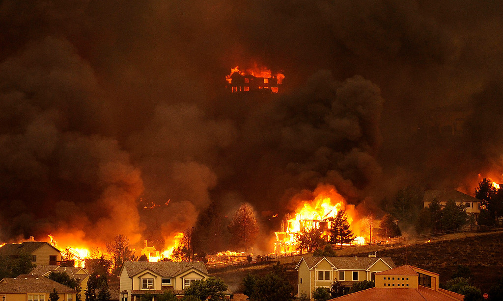 Description of . An entire neighborhood burns near the foothills of Colorado Springs. The Waldo Canyon fire continued to burn northwest of Manitou Springs, Colorado on June 26th, 2012. Helen H. Richardson, The Denver Post