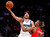 Minnesota Timberwolves Ricky Rubio of Spain (L) shoots over Portland Trailblazers Damian Lillard during the NBA Rising Stars Challenge in Houston, Texas, February 15, 2013. The NBA All-Star basketball game will be played on February 17. REUTERS/Lucy Nicholson