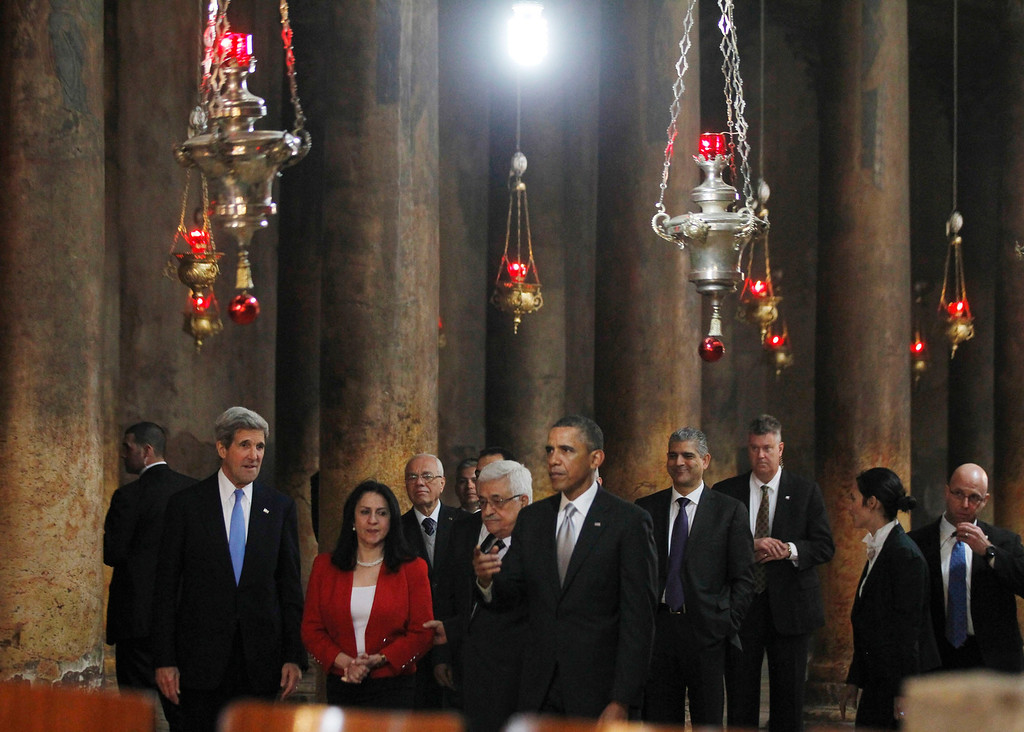 Description of . U.S. President Barack Obama (front) tours the Church of the Nativity in Bethlehem with Palestinian President Mahmoud Abbas (4th L), Secretary of State John Kerry (L) and Bethlehem Mayor Vera Baboun (2nd L), March 22, 2013.   REUTERS/Jason Reed