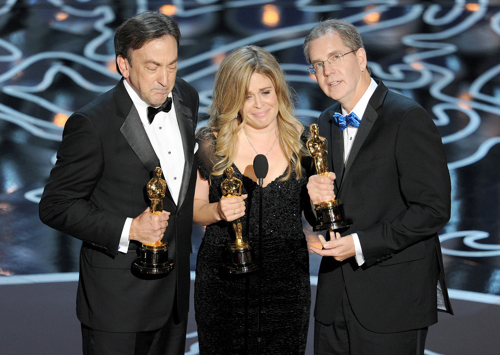 Description of . (L-R) Producer Peter Del Vecho, directors Jennifer Lee and Chris Buck accept the Best Animated Feature Film award for 'Frozen' onstage during the Oscars at the Dolby Theatre on March 2, 2014 in Hollywood, California.  (Photo by Kevin Winter/Getty Images)
