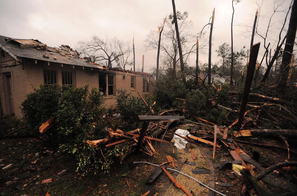 Description of . A house is damaged in Hattiesburg Miss. after a tornado passed through the city Sunday, Feb. 10, 2013. (AP Photo/Hattiesburg American, Ryan Moore)