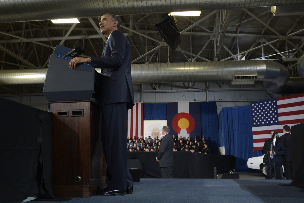 Description of . DENVER, CO. - APRIL 03: President Barack Obama addresses the crowd during a forum at the Denver Police Academy in Denver, CO April 03, 2013. In his first trip to Colorado since his re-election, President Obama urged Congress to act more like the state's Democratic-controlled legislature and quickly pass stronger gun-control laws. During the meeting with law enforcement officials and community leaders, Obama praised lawmakers and Gov. John Hickenlooper for passing some of the nation's strongest gun-control measures after the shootings in Aurora and at a Connecticut elementary school. (Photo By Craig F. Walker/The Denver Post)