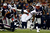 Arian Foster #23 of the Houston Texans gets knocked off of his feet against the New England Patriots during the 2013 AFC Divisional Playoffs game at Gillette Stadium on January 13, 2013 in Foxboro, Massachusetts.  (Photo by Jim Rogash/Getty Images)