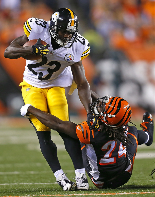 Description of . Felix Jones #23 of the Pittsburgh Steelers is tackled by Adam Jones #24 of the Cincinnati Bengals during the first quarter on September 16, 2013 at Paul Brown Stadium on September 16, 2013 in Cincinnati, Ohio. (Photo by Kirk Irwin/Getty Images)