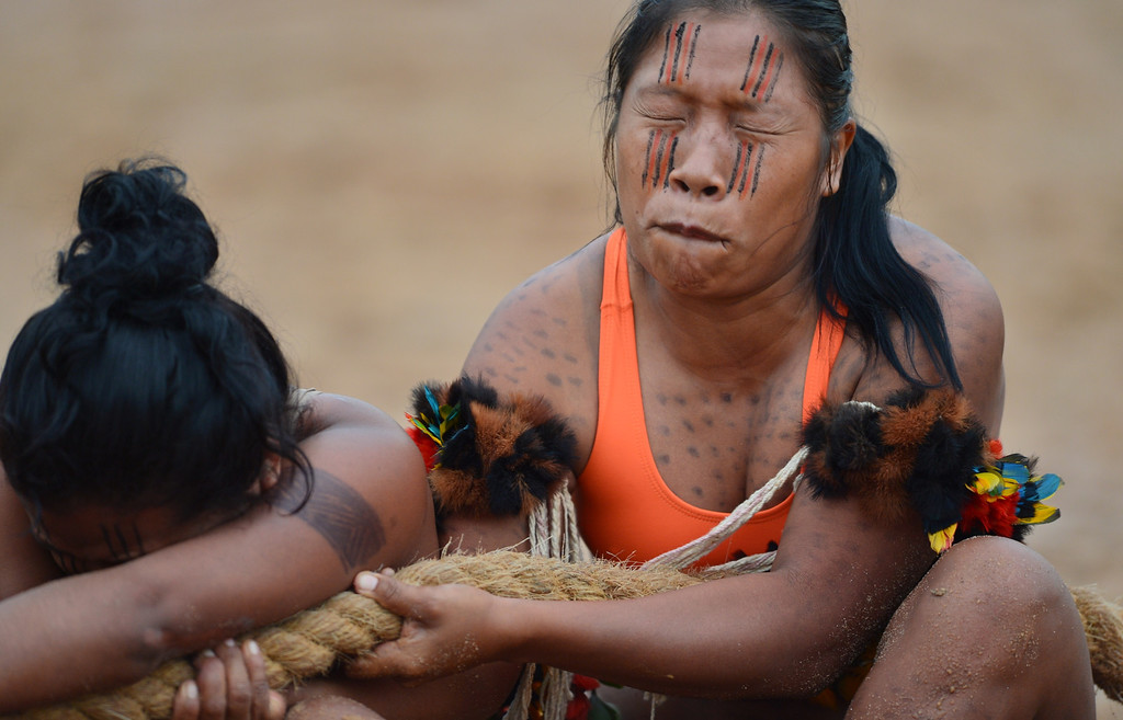 Description of . Brazilian indigenous women of the Kurabakairi tribe participate in a tug of war competition during the XII International Games of Indigenous Peoples in Cuiaba, Mato Grosso state, Brazil on November 12, 2013.  AFP PHOTO / Christophe SIMON/AFP/Getty Images