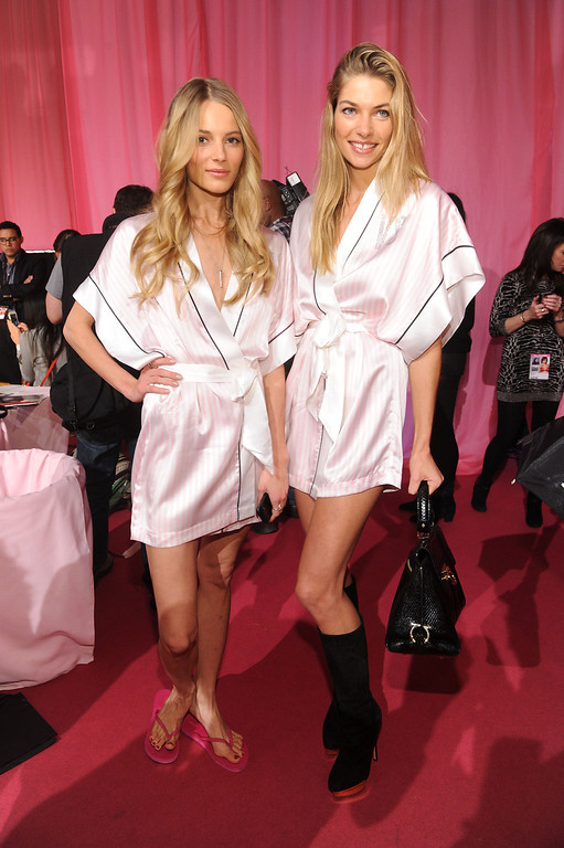 Description of . Models Ieva Laguna and Jessica Hart pose at the 2013 Victoria's Secret Fashion Show hair and makeup room at Lexington Avenue Armory on November 13, 2013 in New York City.  (Photo by Jamie McCarthy/Getty Images)
