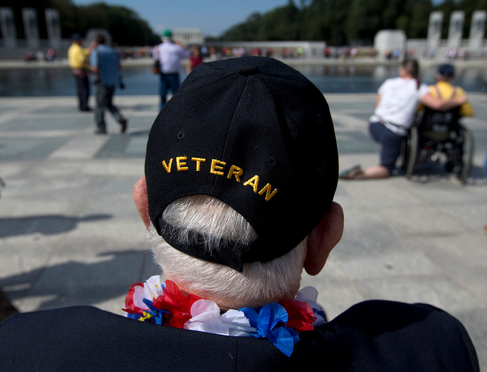 Description of . World War II Veteran George Bloss, from Gulfport, Miss., looks out over the National World War II Memorial in Washington, Tuesday, Oct. 1, 2013. Veterans who had traveled from across the country were allowed to visit the National World War II Memorial after it had been officially closed because of the partial government shutdown. After their visit, National World War II Memorial was closed again. (AP Photo/Carolyn Kaster)