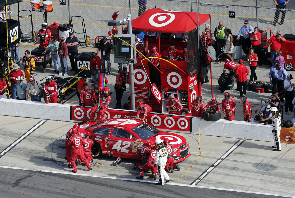 Description of . Juan Pablo Montoya, driver of the #42 Target Chevrolet, pits during the NASCAR Sprint Cup Series Budweiser Duel 1 at Daytona International Speedway on February 21, 2013 in Daytona Beach, Florida.  (Photo by Sam Greenwood/Getty Images)