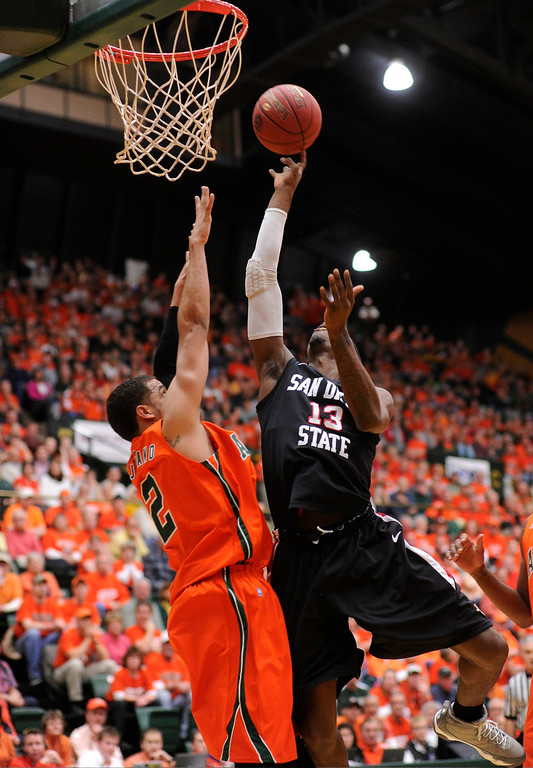 Description of . FT. COLLINS, CO. - FEBRUARY 13: San Diego State's Winston Shepard goes up for a shot on Wednesday night as Colorado State's Daniel Bejarano defends in a key Mountain West game at Moby Arena in Fort Collins, Colorado.  (Photo By Karl Gehring/The Denver Post)