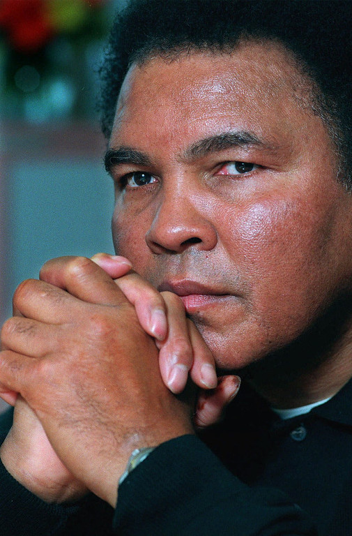 Description of . Boxing legend Muhammad Ali is shown in this Tuesday Feb. 2, 1999 file photo.  (AP Photo/Richard Drew)