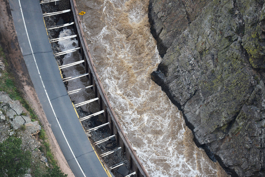 Description of . A large section of Colorado U.S. 34, completely washed out from recent flooding of the Big Thompson River in the Big Thompson Canyon in Larimer County Colorado Saturday morning, September 14, 2013. (Photo By Andy Cross/The Denver Post)