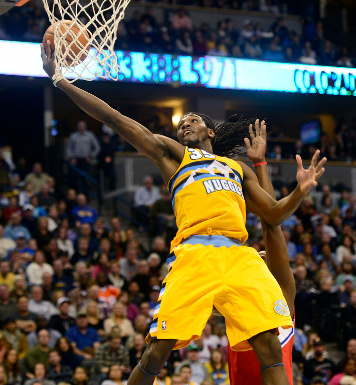 Description of . Denver Nuggets small forward Kenneth Faried (35) cannot convert an alley oop against the Los Angeles Clippers during the first half at the Pepsi Center on Tuesday, January 1, 2013. AAron Ontiveroz, The Denver Post