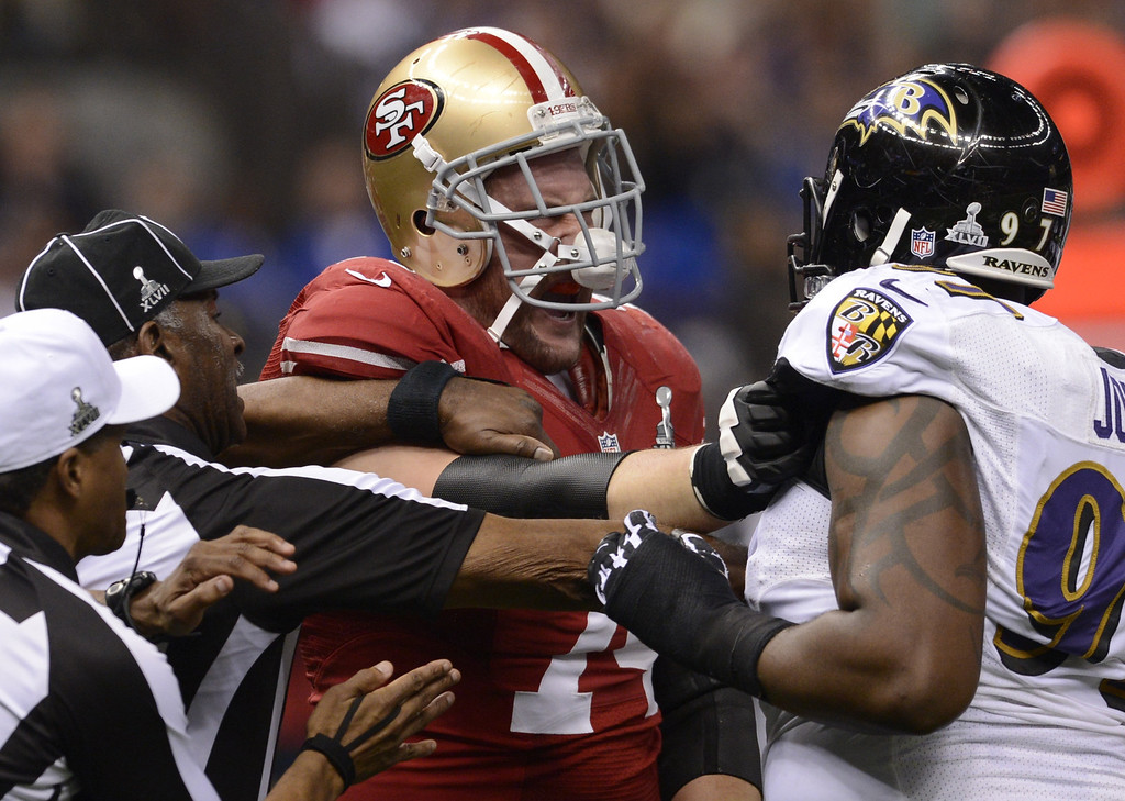 Description of . Arthur Jones (R) of the Baltimore Ravens and Joe Staley (L) of the San Francisco 49ers scuffle during Super Bowl XLVII at the Mercedes-Benz Superdome on February 3, 2013 in New Orleans, Louisiana.    TIMOTHY A. CLARY/AFP/Getty Images