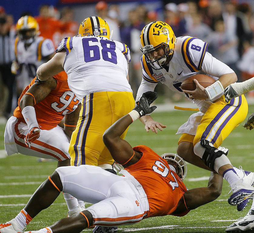 Description of . LSU quarterback Zach Mettenberger (8) is sacked by Clemson defensive end Malliciah Goodman (97) during the first half of the Chick-fil-A Bowl NCAA college football game, Monday, Dec. 31, 2012, in Atlanta. (AP Photo/John Bazemore)