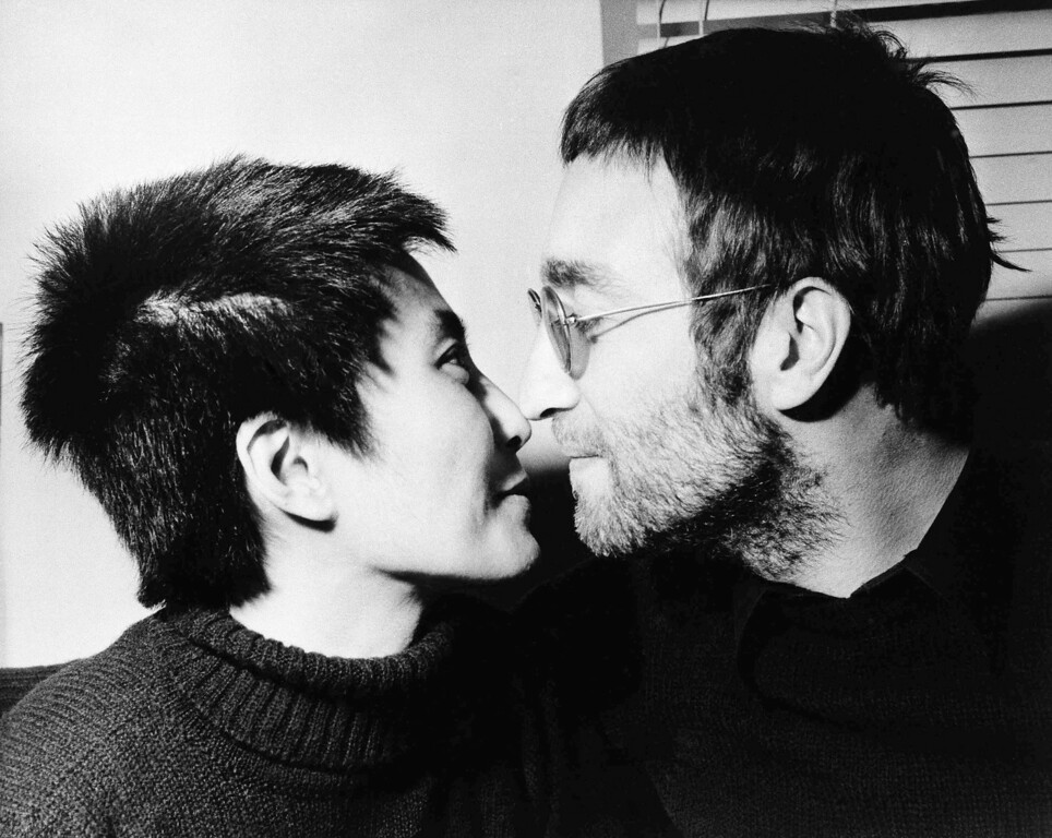 Description of . An Eskimo kiss (rubbing noses) is enjoyed by Beatle John Lennon and his Japanese wife Yoko Ono, during an interview held in London on Feb. 9. 1970. Last month both had their hair cut short at Aalborg, Denmark. Hair will be auctioned later in London and proceeds will go to Black Power, an organization interested in the leisure and welfare of colored people in Britain. (AP Photo)