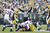 Aaron Rodgers #12 of the Green Bay Packers gets tackled by Everson Griffen #97 of the Minnesota Vikings during the game at Lambeau Field on December 2, 2012 in Green Bay, Wisconsin. The Packers won 23-14. (Photo by Joe Robbins/Getty Images)