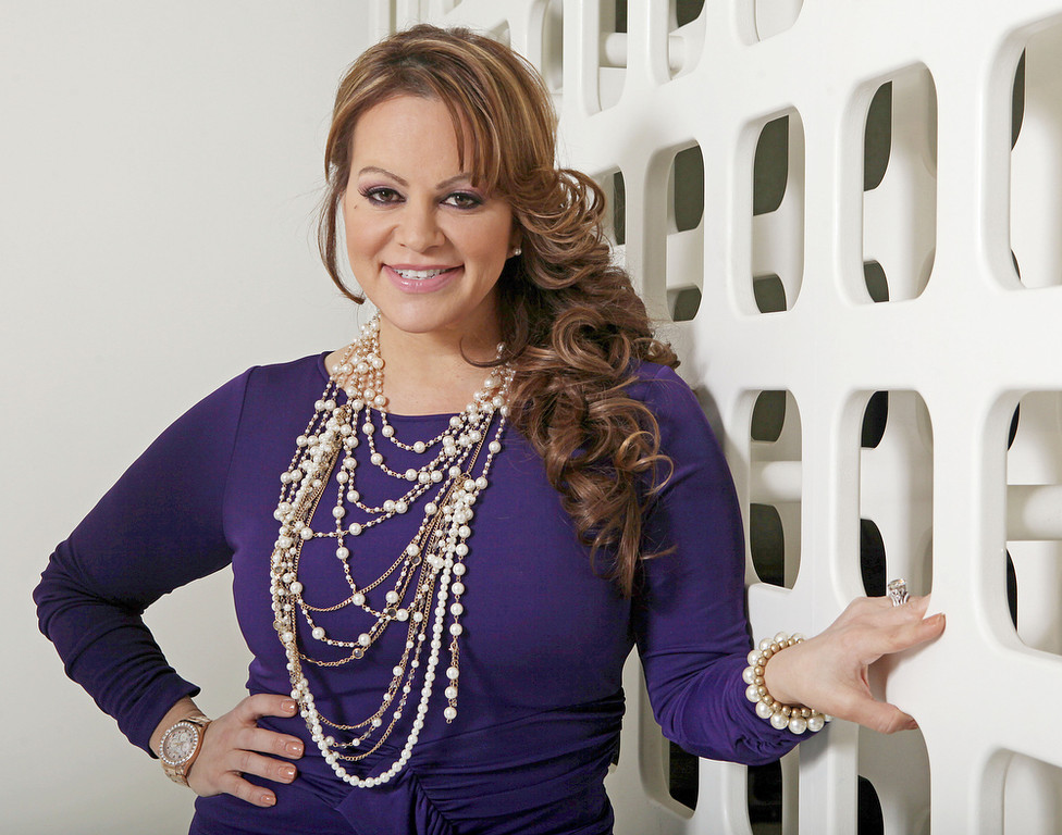 Description of . In this March 8, 2012, file photo, Mexican-American singer and reality TV star Jenni Rivera poses during an interview in Los Angeles. Mexican authorities confirmed that the plane in which Rivera was traveling disappeared early Sunday, Dec. 9, 2012, after leaving the Mexican northern city of Monterrey where she performed in concert on Saturday night. (AP Photo/Reed Saxon, file)
