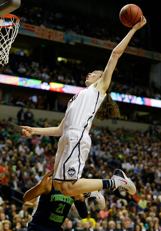 Description of . Connecticut forward Breanna Stewart (30) shoots against Notre Dame guard Kayla McBride (21) during the first half of the championship game in the Final Four of the NCAA women's college basketball tournament, Tuesday, April 8, 2014, in Nashville, Tenn. (AP Photo/Mark Humphrey)