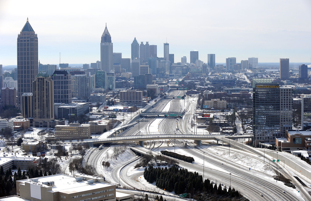 Description of . In this view looking south toward downtown Atlanta, the ice-covered interstate system is empty after a winter snow storm   slammed the city with over 2 inches of snow that turned highways into parking lots when motorists abandoned their vehicles creating massive traffic jams lasting through Wednesday, Jan. 29, 2014, in Atlanta. While such amounts of accumulation barely qualify as a storm in the north, it was enough to paralyze the Deep South. (AP Photo/David Tulis)