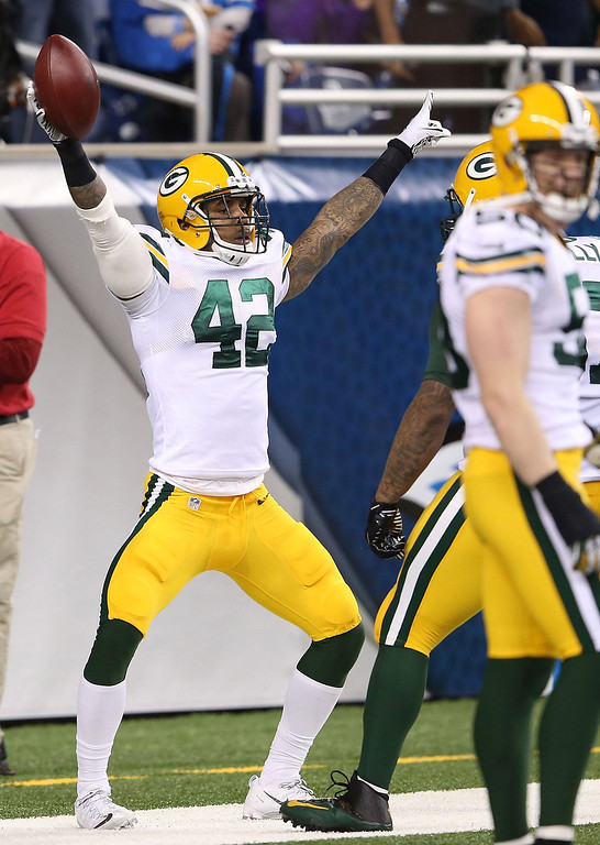 . Morgan Burrnett #42 of the Green Bay Packers celebrates after scoring following a fumble by Matthew Stafford #9 of the Detroit Lions during the second quarter of the game  at Ford Field on November 28, 2013 in Detroit, Michigan.  (Photo by Leon Halip/Getty Images)
