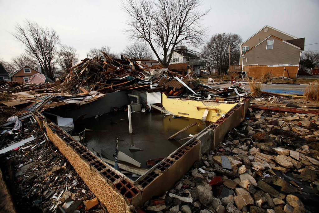 Description of . The debris of a home damaged by Superstorm Sandy is seen one month after the disaster at the zone of Union Beach in New Jersey November 29, 2012. REUTERS/Eduardo Munoz