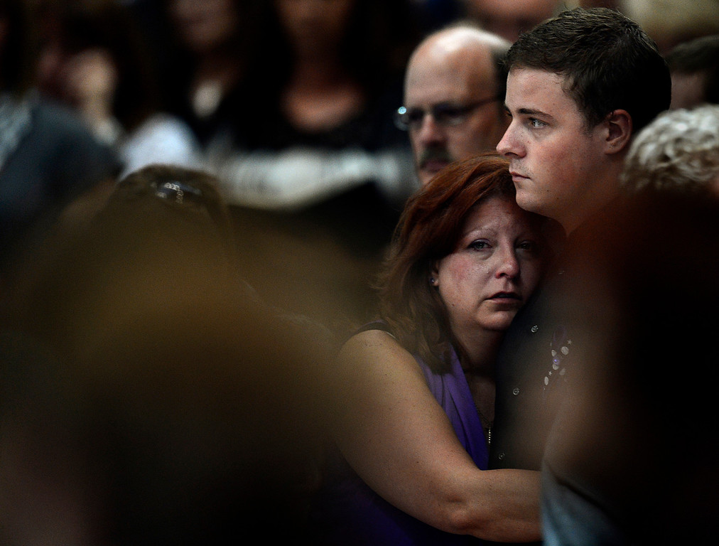 Description of . Theresa Hoover holds her son, Wil Boik, 22, during the funeral of her younger son, AJ Boik, on Friday, July 27, 2012 at the Queen of Peace Catholic Church in Aurora. AJ Boik was killed in the Aurora Theater shooting. Joe Amon, The Denver Post