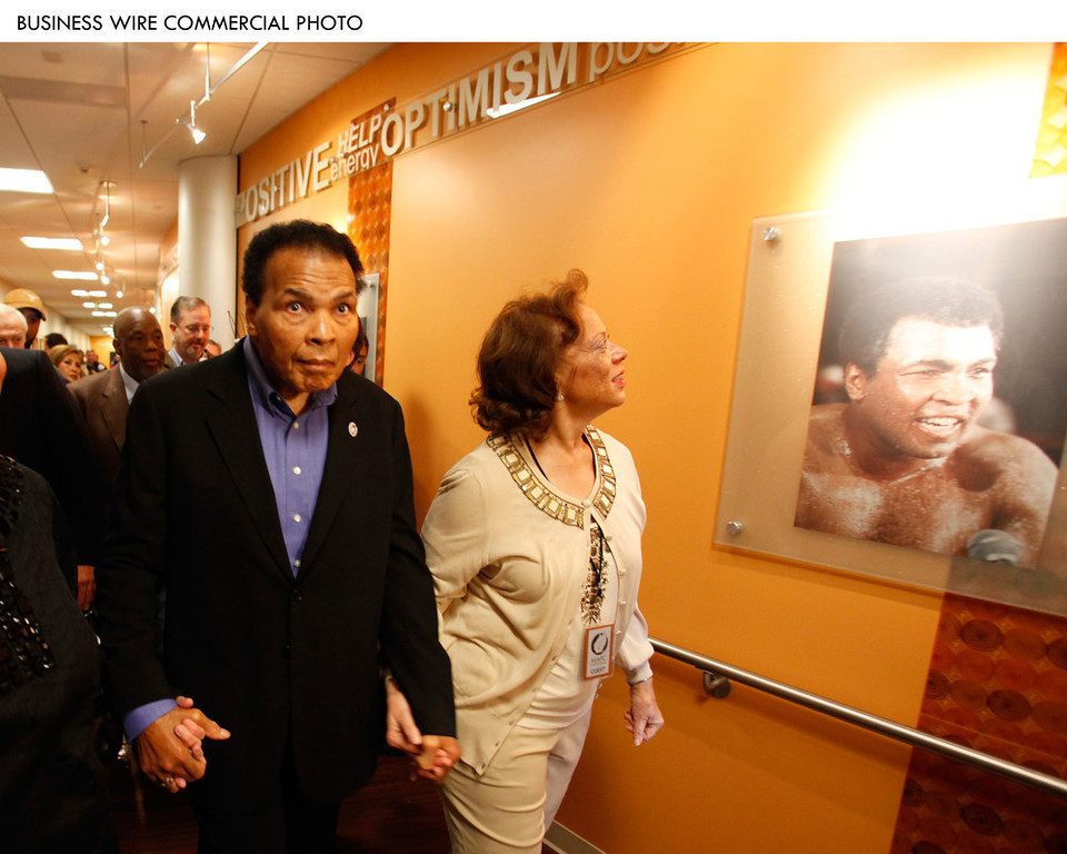 Description of . Muhammad and Lonnie Ali tour the new $4 million Muhammad Ali Parkinson Center in the Barrow Neurological Institute at St. Joseph's Hospital in Phoenix. The Alis participated in the grand opening today of the center, which has been decorated with images from throughout Muhammad's boxing career. The Muhammad Ali Parkinson Center at Barrow will provide care and treatment to thousands of Parkinson patients from throughout the United States. The 10,000-square-foot facility is the most comprehensive Parkinson's center in the nation. 2009 (Photo: Business Wire)