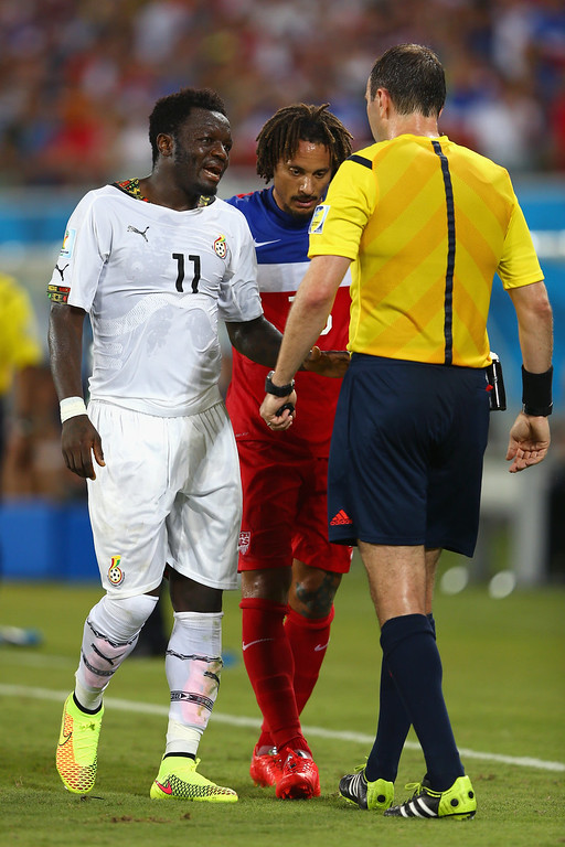 Description of . Referee Jonas Eriksson speaks to Sulley Muntari of Ghana and Jermaine Jones of the United States after a challenge during the 2014 FIFA World Cup Brazil Group G match between Ghana and the United States at Estadio das Dunas on June 16, 2014 in Natal, Brazil.  (Photo by Michael Steele/Getty Images)