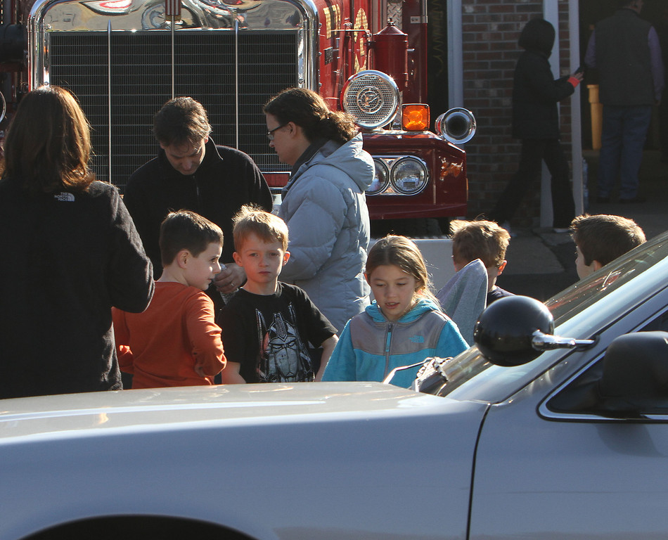 Description of . School children wait for their parents at the Sandy Hook firehouse following a mass shooting at the Sandy Hook Elementary School in Newtown, Conn. where authorities say a gunman opened fire, leaving 27 people dead, including 20 children, Friday, Dec. 14, 2012. (AP Photo/The Journal News, Frank Becerra Jr.)
