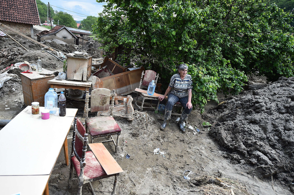 Description of . A woman sits on a chair as she rests next to furniture in her mud covered back yard in Krupanj, some 130 kilometers south west of Belgrade, on May 20, 2014, after it was hit with floods and landslides, cutting the western Serbian town off for four days. Serbia declared three days of national mourning on May 20 as the death toll from the worst flood to hit the Balkans in living memory rose and health officials warned of a possible epidemic.   AFP PHOTO / ANDREJ ISAKOVIC/AFP/Getty Images