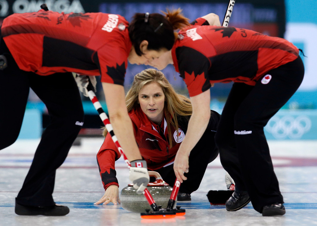 Description of . Canada's skip Jennifer Jones delivers the stone during women's curling competition against South Korea at the 2014 Winter Olympics, Monday, Feb. 17, 2014, in Sochi, Russia. (AP Photo/Robert F. Bukaty)