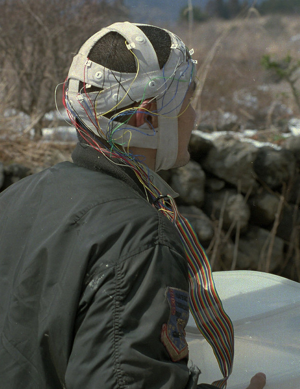 Description of . A sect member of the Aum Shinri Kyo is seen wearing special headgear at the groups' headquarters at the Kamikuishiki compound, west of Tokyo on March 27, 1995. The headgear was said to help receive the brain wave patterns of the cult's leader Shoko Asahara. Asahara and his followers believed he was Christ reincarnated and that he had to defeat the enemies of Japan in order to survive World War III or armageddon.  (AP Photo/Itsuo Inouye)