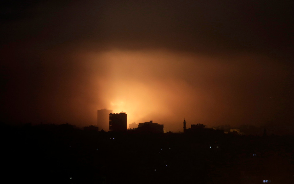 Description of . An explosion from an Israeli strike lights up the sky in eastern Gaza City, early Wednesday, July 30, 2014, amid Israel's heaviest air and artillery assault in more than three weeks of Israel-Hamas fighting. (AP Photo/Khalil Hamra)