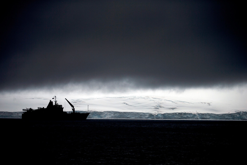 Description of . In this Jan. 25, 2015 photo, Chile's Navy ship Aquiles moves alongside the Hurd Peninsula, seen from Livingston Islands, part of the South Shetland Islands archipelago in Antarctica. This is also the place where a hole in the ozone layer, from man-made refrigerants and aerosols, parks for a couple months when sunlight creeps back to Antarctica in August. It triggers a chemical reaction that destroys ozone molecules, causing a hole that peaks in September and then closes with warmer weather in November. (AP Photo/Natacha Pisarenko)